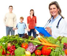 Doctor nutritionist and family. - stock photo