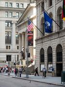 Wall Street and the Federal Hall in New York Stock Photos