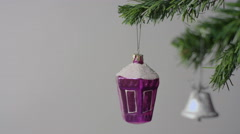 Purple Christmas toy and silver bell on the Christmas tree branch Stock Footage
