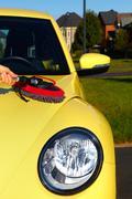 Car with wax and polish cloth. - stock photo