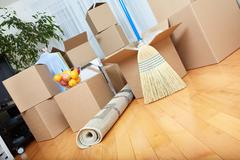 Moving boxes in new house. - stock photo