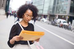 An office girl holding envelopes Stock Photos