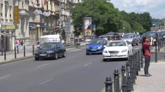 Driving cars on Wilsonova Street near CSOB Bank in Prague Stock Footage