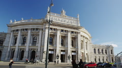Austrian National Theatre with Fiaker passing - stock footage