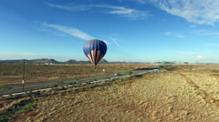 Aerial towards hot air balloon launching Stock Footage