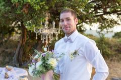 Groom is looking forward to the bride appearance - stock photo