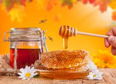 Fresh honey with dipper - stock photo