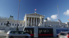 Tram and Traffic passing the Parliament Building Stock Footage