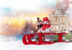 Christmas snowmen on sledge Stock Photos