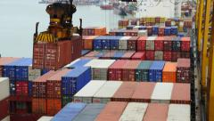 Port - Vessel with containers being loaded onto a ship Stock Footage