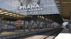 Prague Main Railway Station logo and people waiting for a train Stock Footage