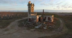 Aerial Drone scene of abandoned Slaughterhouse at sunset, dead trees in Epecuen Stock Footage