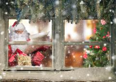 Atmospheric Christmas window with Santa Claus Stock Photos