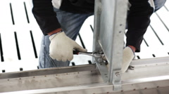 Workers build a metal structure wrench Stock Footage