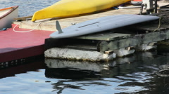 Pan shot of canoe and dock Stock Footage