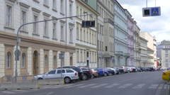 Cars parked along a row of buildings in Prague Stock Footage