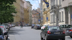 Driving cars near other cars parked on Opletalova street in Prague Stock Footage
