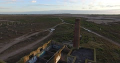 Aerial Drone scene flying down to the floor abandoned Slaughterhouse Epecuen Stock Footage