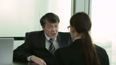 Angry boss with female workers in the office Stock Footage