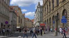 People walking on Melantrichova street, next to Czech savings Bank in Prague Stock Footage