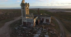 Aerial Drone scene of abandoned Slaughterhouse at Epecuen, bird flying away Stock Footage