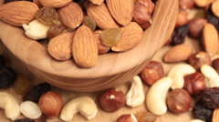 Nuts in a wooden vase. Stock Footage