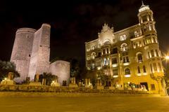 Illuminated building in the city center in Azerbaijan, Baku. - stock photo