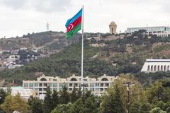 Azerbaijan flag waving on the wind in front of the city Stock Photos
