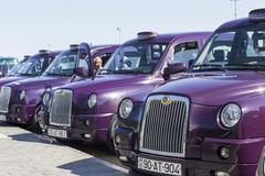 Stock Photo of Local cabs waiting in line for passengers in Baku, Azerbaijan.