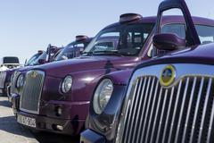Local cabs waiting in line for passengers in Baku, Azerbaijan. - stock photo