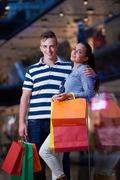 Stock Photo of young couple with shipping bags