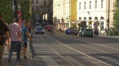 Traffic on Smetanovo nabrezi and tourists crossing the street, Prague Stock Footage