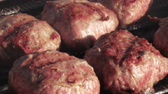 Cooking hamburgers on grill Stock Footage
