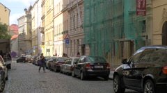 Cars parked on a cobbled street in Prague Stock Footage