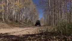 Recreation 4x4 RZR drives mountain dirt trail road autumn 4K 010 - stock footage
