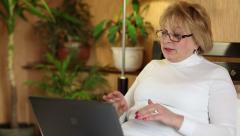 Senior woman communicates using laptop. Woman with laptop Stock Footage