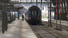 Blue train stopped in Prague main railway station Stock Footage