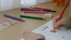 Stock Video Footage of Schoolgirl doing her homework in maths (version 1)