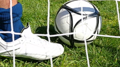 Footballer tying football boots preparing for a football soccer match Stock Footage