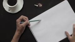 Artist drawing on sketchbook, top view Stock Footage
