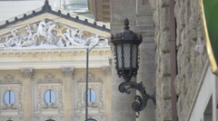Vintage street lamp at Petschkův palác near the State Opera, Prague Stock Footage