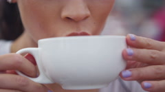 4K Close up portrait beautiful Asian woman drinking coffee at outdoor cafe table - stock footage