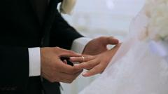 groom wears the ring bride - stock footage