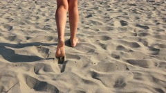 4k Woman walking on sand, footsteps in sand, Back view steadycam shot Stock Footage