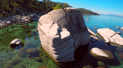 An aerial shot over beautiful boulders and clear water in Lake Tahoe, Nevada. Arkistovideo