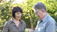 Elder Couple With Apples - stock footage