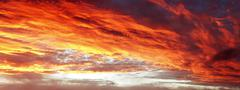 Sunlit clouds in summer sky Stock Photos
