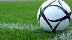 Dolly of a soccer ball put on the corner point of the football field - stock footage