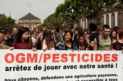 people with banner during the demonstration against Monsanto - stock photo