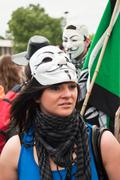 woman with anonymous mask - stock photo